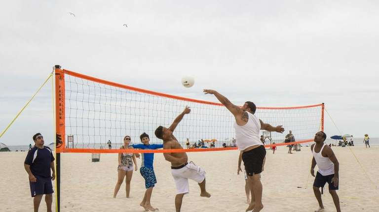 People play volleyball on Jones Beach in Wantagh.