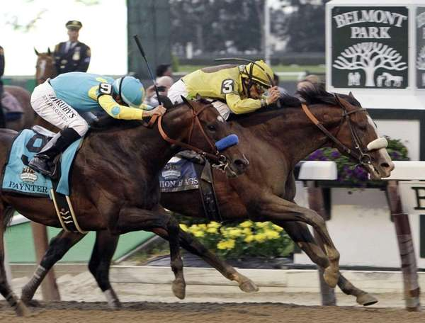Jockey John Velazquez, right, drives Union Rags past