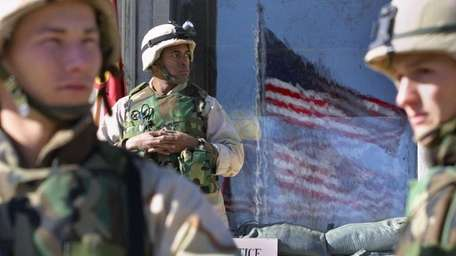 Marines stand guard at the US embassy in