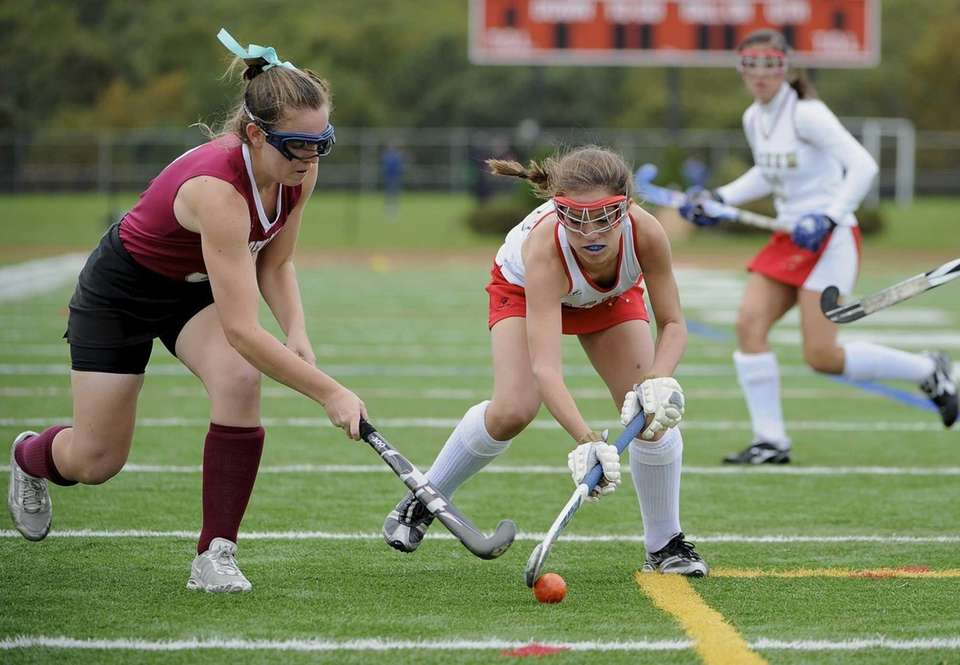 Sachem East forward Cara Trombetta is defended by