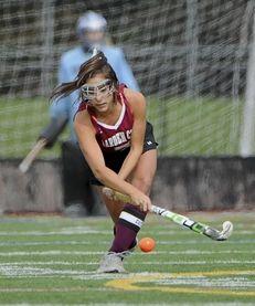 Garden City's Victoria Piscopo passes the ball against