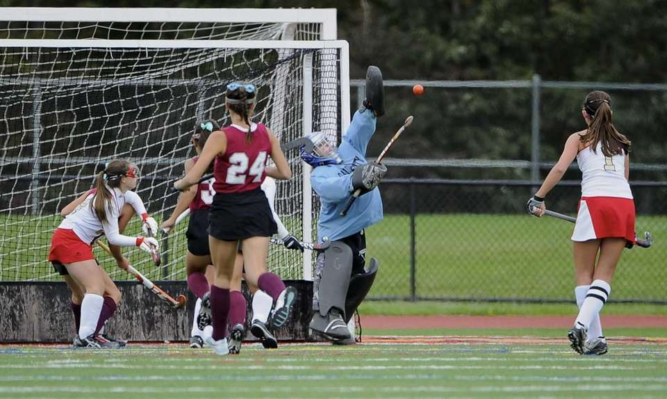 Garden City goalkeeper Allison Miller stops a high