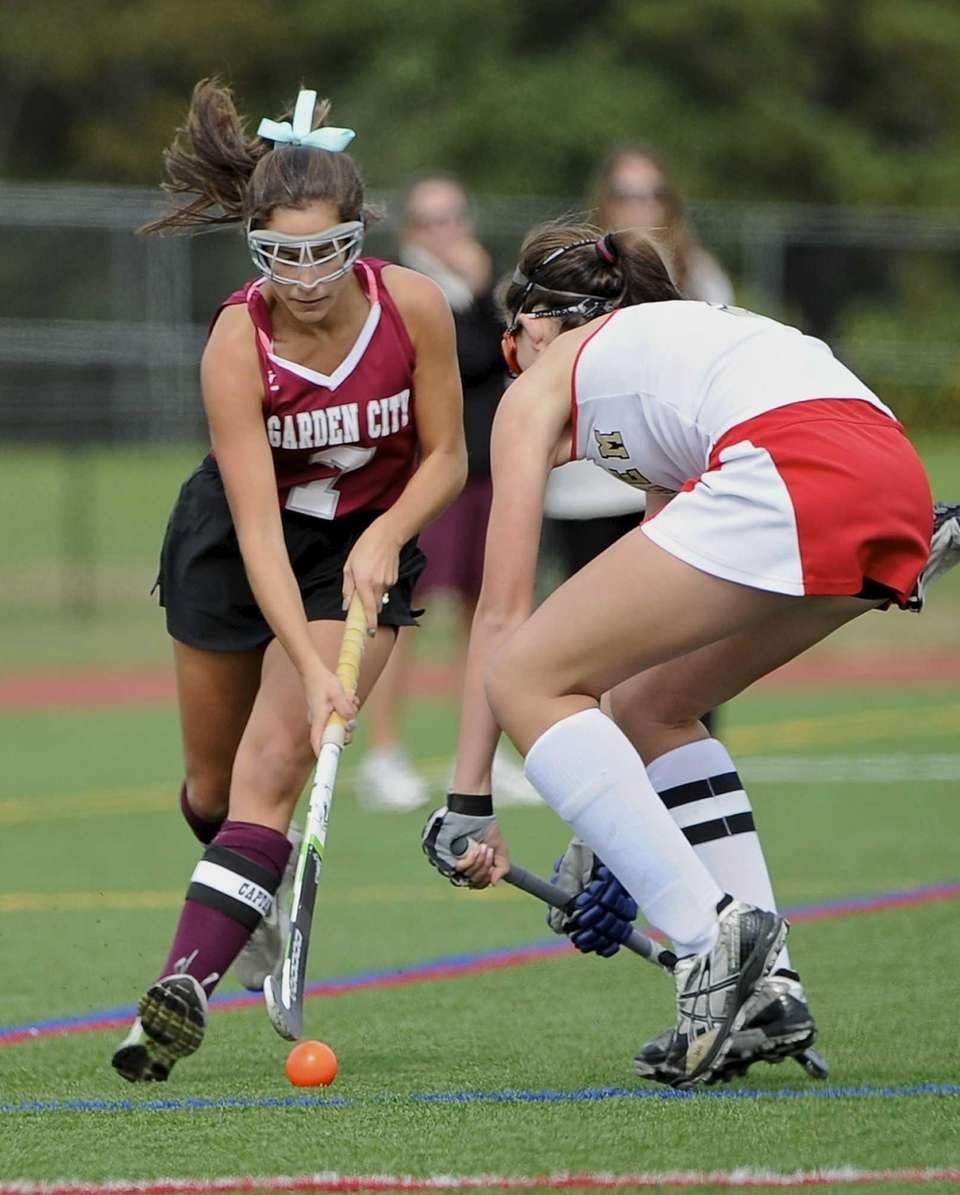 Sachem East midfielder Kaitlin Trombetta defends agaist Garden