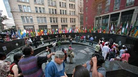 Visitors tour the African Burial Ground National Monument