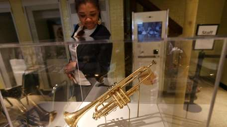 Airica Daley, visiting from Chicago, views a Selmer