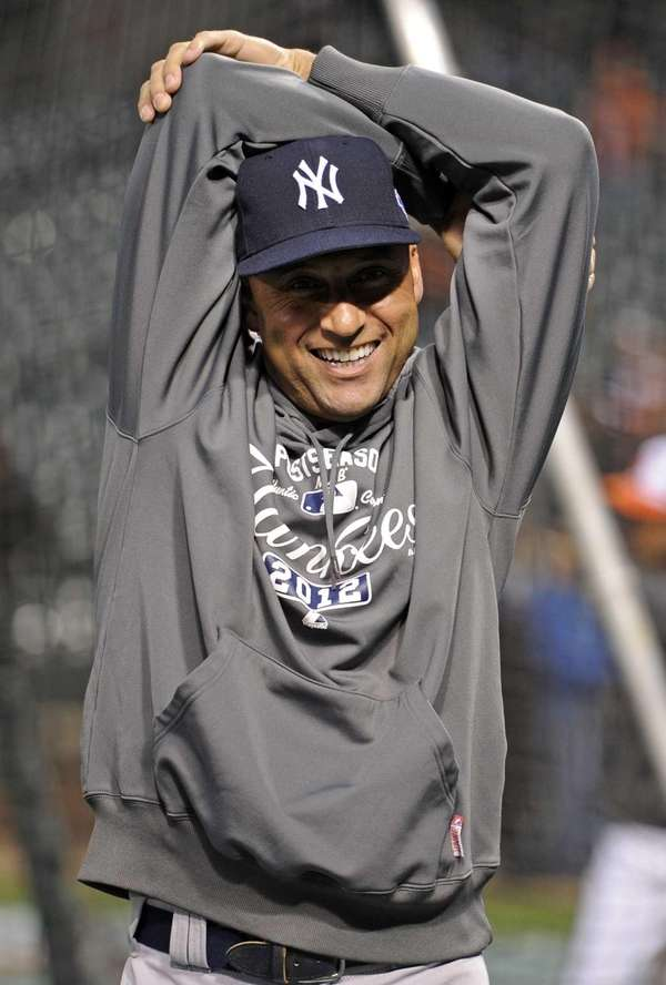 Derek Jeter warms up before Game 2 of