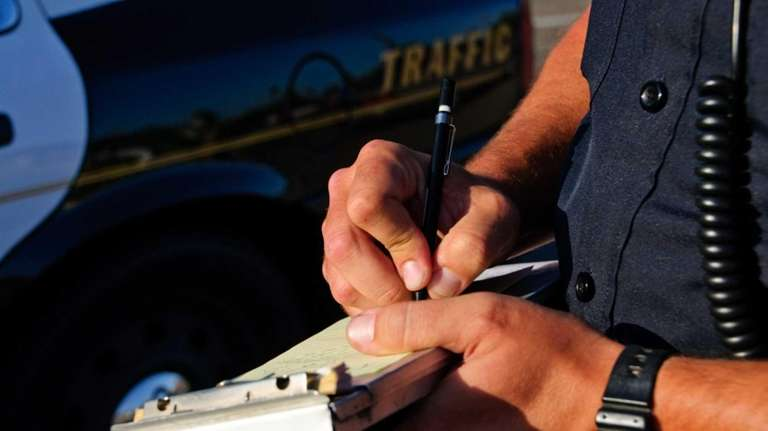 A cop writing a ticket.