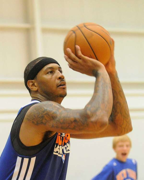 Carmelo Anthony works on three-point shooting during the