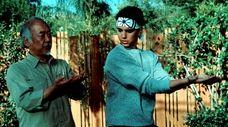 Pat Morita teaches Ralph Macchio some martial art