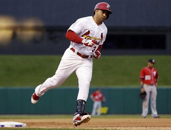 St. Louis Cardinals outfielder Carlos Beltran rounds the