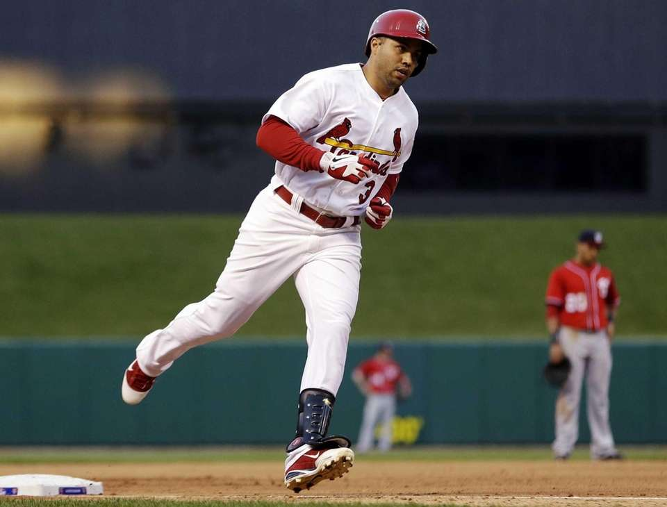 St. Louis Cardinals outfielder Carlos Beltran rounds the