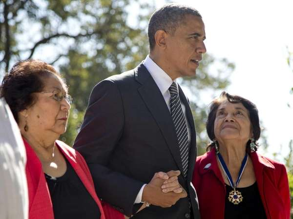 President Barack Obama walks with Cesar Chavez' widow