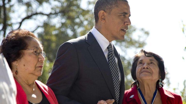 President Barack Obama walks with Cesar Chavez' widow