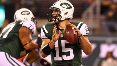 Tim Tebow looks to pass in the first