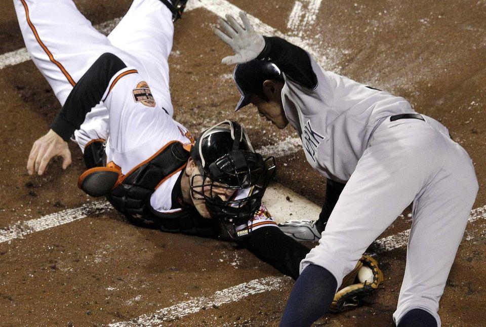 Ichiro Suzuki leaps past Baltimore Orioles catcher Matt
