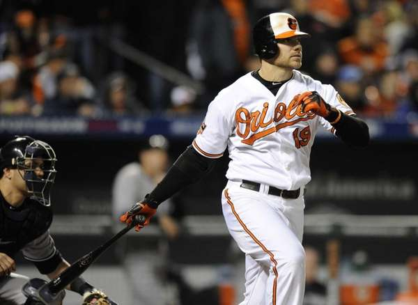 The Baltimore Orioles' Chris Davis singles in the