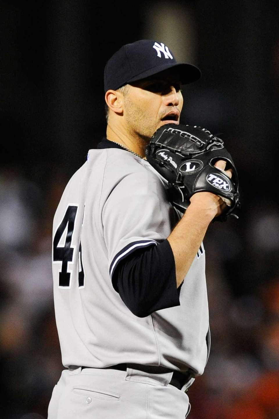 Andy Pettitte looks in for the sign during