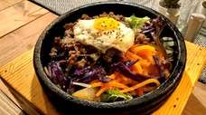 Dolsot bibimbap (beef and vegetables served over rice