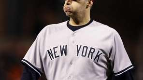 Yankees starting pitcher Andy Pettitte reacts as he