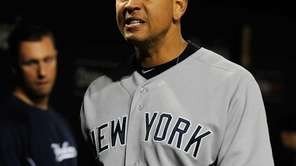 Alex Rodriguez reacts in the dugout after losing
