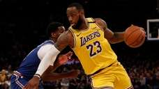 LeBron James of the Los Angeles Lakers drives