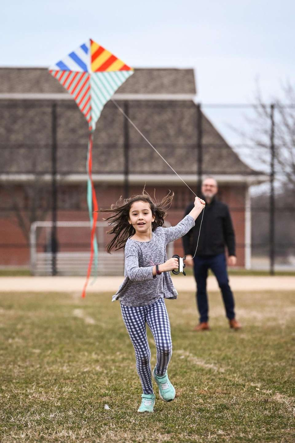 Norah Wouters Almeida, 8, of Locust Valley, catches