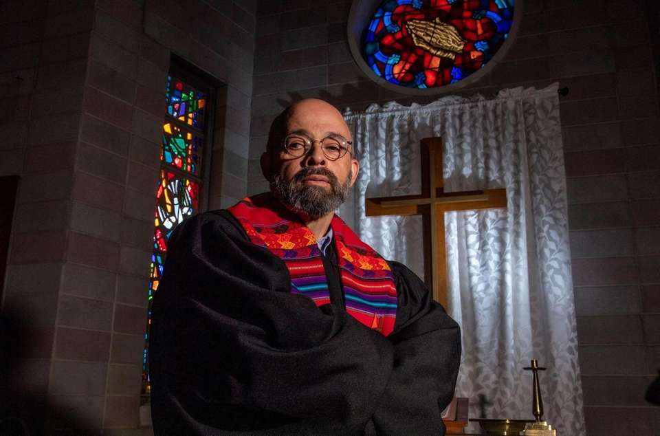 Pastor Hector Rivera in his sanctuary at First
