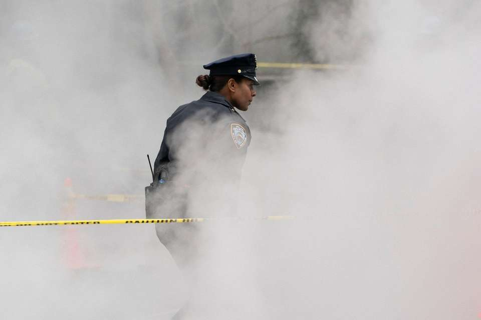 A police officer walks steam after a water