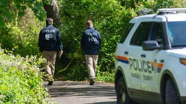 Nassau police with federal partners conduct an investigation