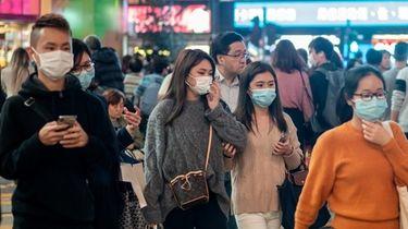 Pedestrians wear face masks to prevent spread of