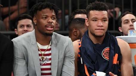 The Knicks' Dennis Smith Jr., left, and Kevin