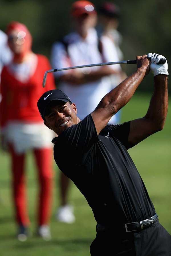 Tiger Woods plays his second shot on the