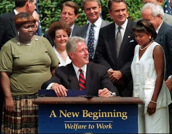 President Bill Clinton prepares to sign legislation in