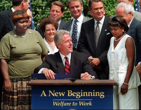 President Bill Clinton prepares to sign legislation in