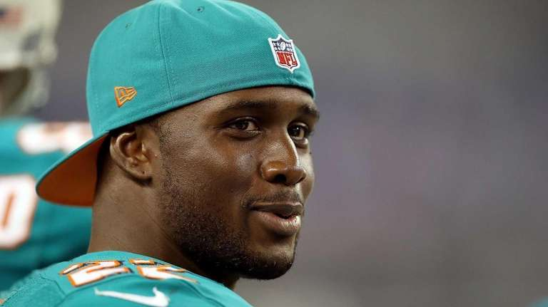 Miami Dolphin Reggie Bush on the sidelines during