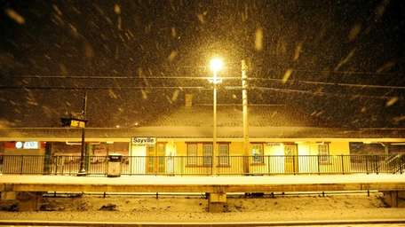The Sayville train station is covered in snow