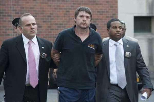 David Albert Mitchell escorted by police, Sept. 13,