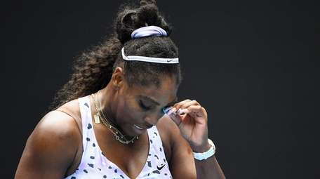Serena Williams reacts after a point against China's