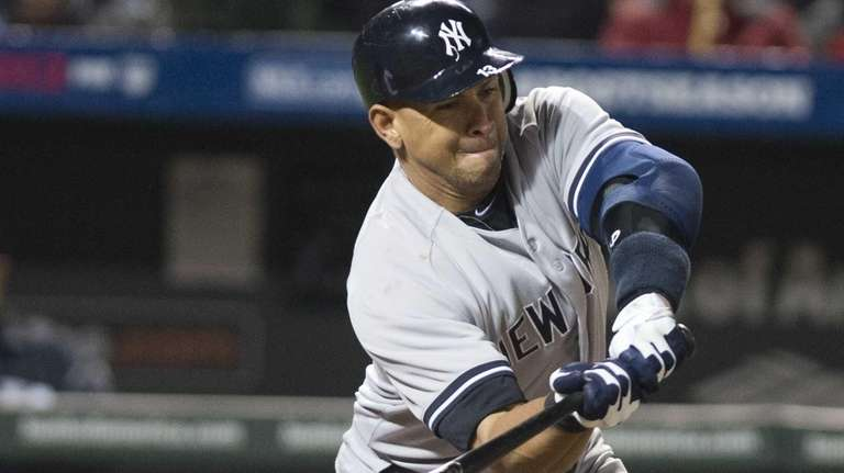 Alex Rodriguez swings and misses during an at-bat
