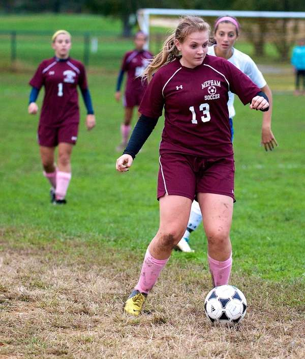 Mepham midfielder Sam Picinich looks to pass the