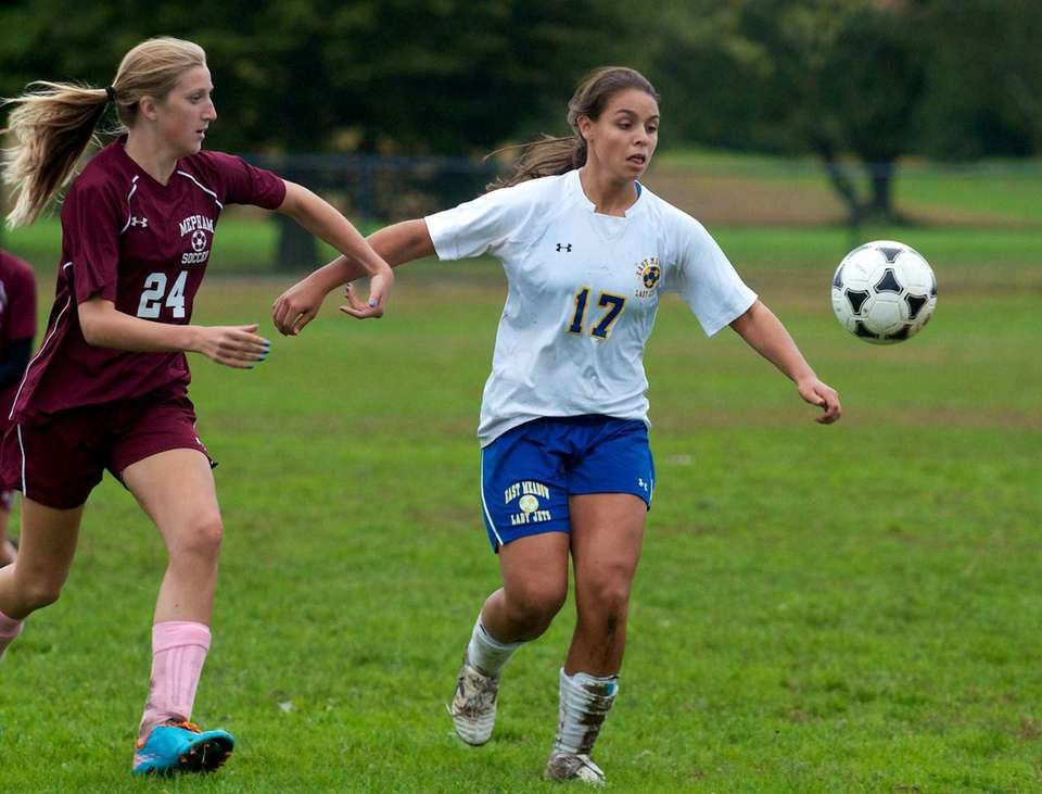East Meadow's Alexis Vaz beats Mepham defender Emily