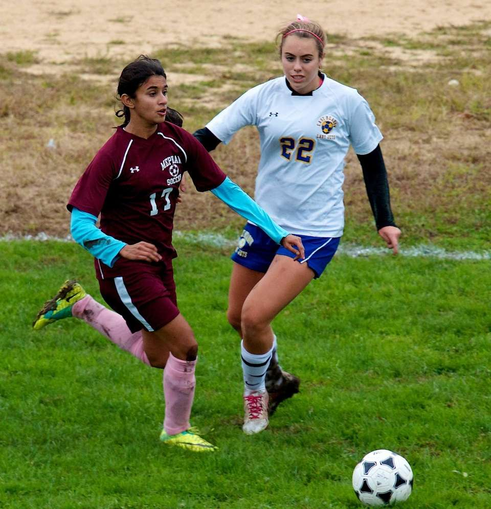 Mepham Andrea D'Sa attempts to dribble past East