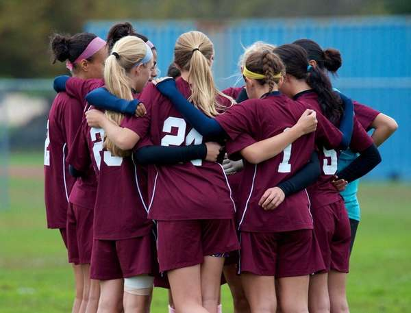 The Mepham girls soccer team huddles before its