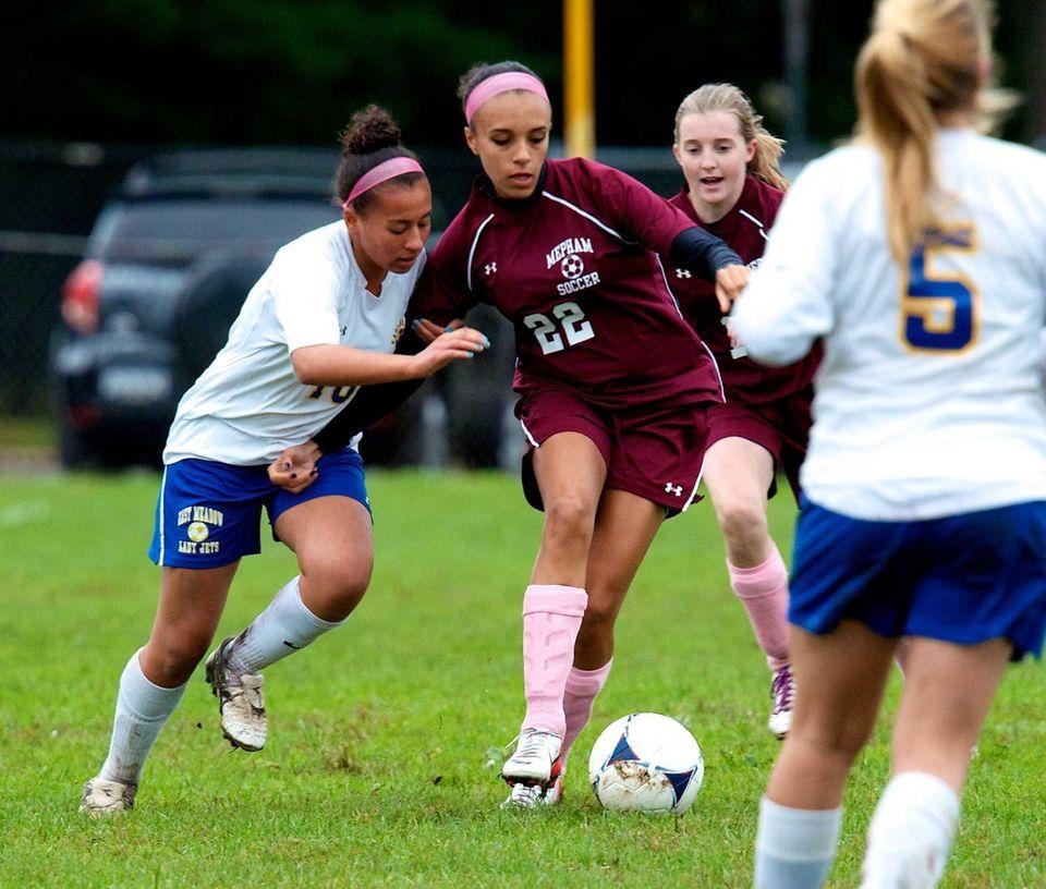 Mepham forward Kelsey Simpson battles for the ball