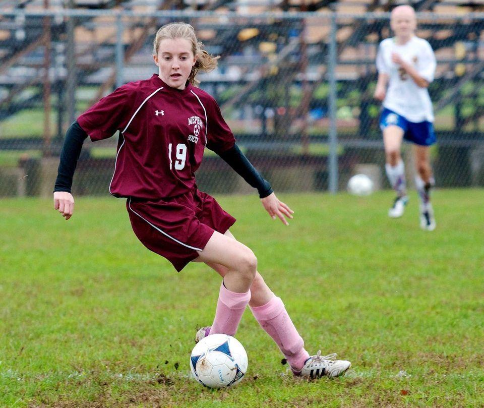 Mepham midfielder Erin Gilroy dribbles the ball toward