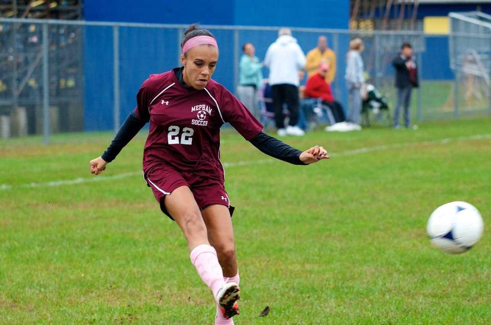 Mepham forward Kelsey Simpson crosses the ball into