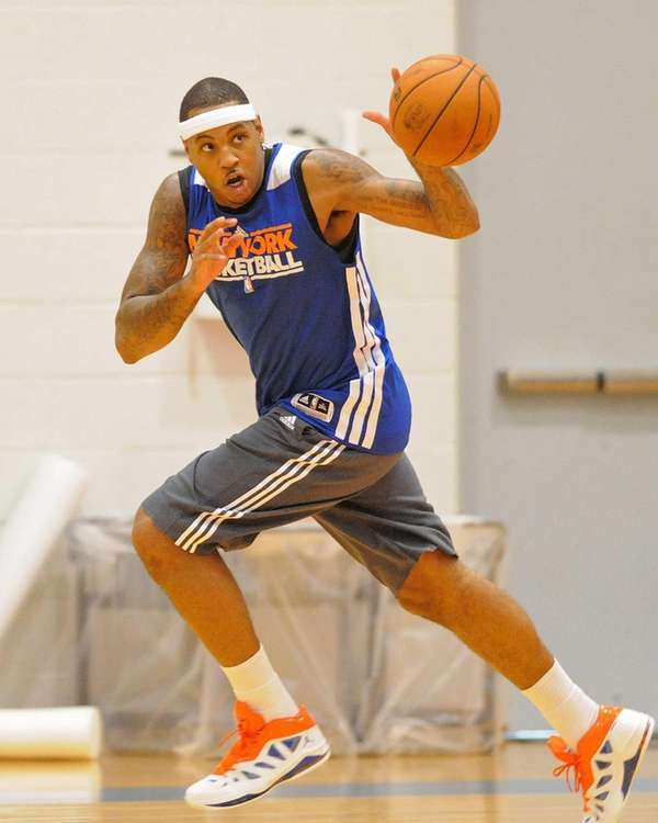 Carmelo Anthony passes while racing downcourt during team