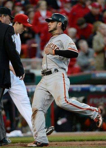 The San Francisco Giants' Gregor Blanco scores during