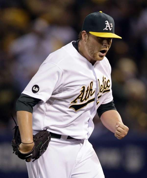 Oakland Athletics starting pitcher Brett Anderson pumps his