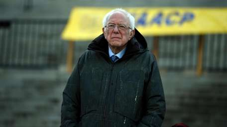 Democratic presidential candidate Sen. Bernie Sanders, I-Vt., stands